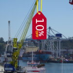 A crane loading a 10% discount label onto a vessel. Used to represent our discount on logistics training courses.