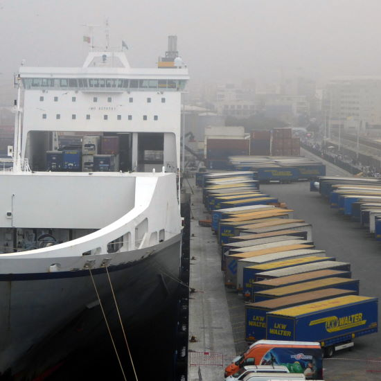 A roll-on roll-off RORO vessel alongside a quay full of trailers waiting to be loaded onto the vessel by the terminal tractors Used in our logistics training courses
