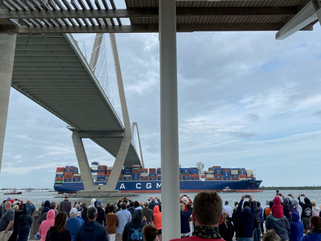 Crowd gathers to see the Very Large Container Ship - CMA CGM Brazil - approach the port of Charleston on its record breaking journey.
